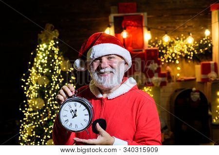 Santa Man Hold New Year Clock. Christmas Clock. Winter Holidays. Time To Celebrate. New Year Party.