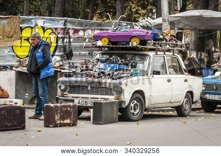 Tbilisi, Georgia. November 23, 2019. Different Items Placed On Old Soviet Cars And Sold At The Flea