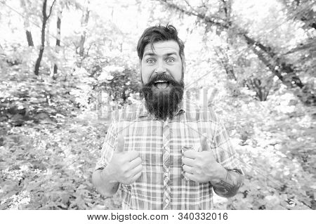 Just Give A Thumbs Up. Happy Guy Gesturing Thumbs Ups On Summer Landscape. Hipster With Mustache And