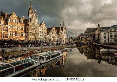 Graslei Quay In The Historic City Center Of Ghent, With Boats Bridge And Old Flemish Buildings, Belg