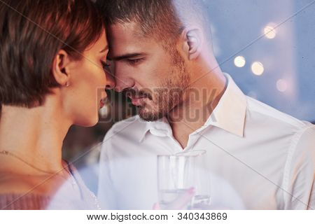 Unshaved Man Going To Kiss That Beautiful Girl. Nice Couple Celebrating New Year In The New Year Dec