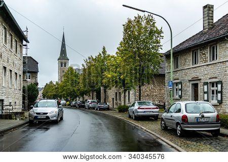 Breinig-stolberg, Germany - Sept. 08, 2019: Village View On Main Street And Saint-barbarachurch In T