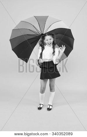 Fancy Schoolgirl. Girl With Umbrella. Rainy Day. Happy Childhood. Rainbow Style. Kid Happy With Umbr