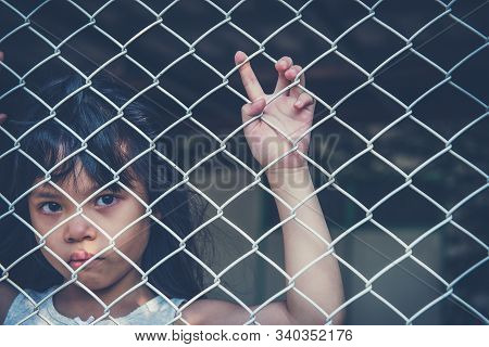 Sad Asian Girl Child Alone In Cage Was Imprisoned Make No Freedom Or Lack Of Freedom