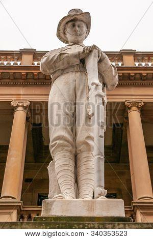 Newcastle, Australia - December 10, 2009: Closeup Of White Statue Of Soldier Resting On Rifle At Ww1