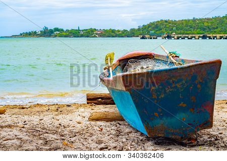 Old Blue Wooden Fishing Boat Docked On Sea Shore/ Seashore On White Sand Beach Coast Landscape With