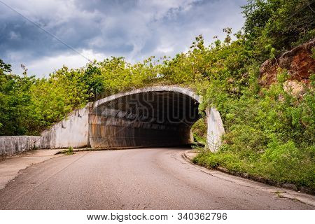 Entry/ Entrance/ Entryway/ Exit Of A Dark Tunnel On Countryside Roadway/ Street. Opening To Undergro