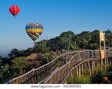 Hot Air Balloons On Blue Sky At Ban Doi Sa-ngo Chiangsaen, Chiang Rai Province, Thailand.