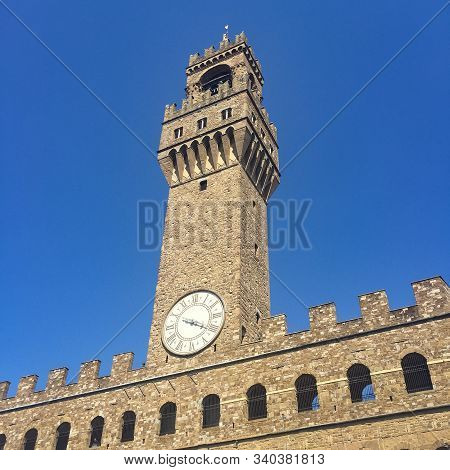 Clock Tower And Embattlements On Palazzo Vecchio In Florence