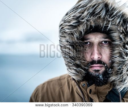Man on winter expedition into Arctic wilderness