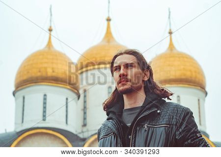 A Man Stands On The Background Of The Golden Domes Of The Orthodox Church