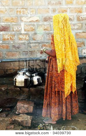 Indian woman waiting at a water source in Thar Desert, India