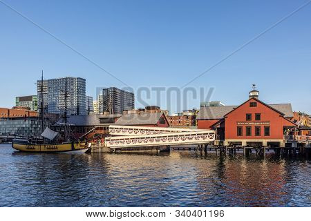 Boston, Usa - Sep 12, 2017: Pier With Historic Building Of The Harbor Site Where The Boston Tea Part