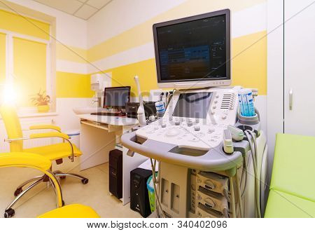 Interior Of Hospital Room With Ultrasound Machine And Bed. Sonography. Health Tests Concept. Closeup