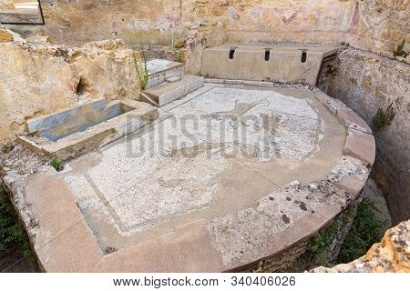 Piazza Armerina, Sicily, Italy - August 24, 2017: Ancient Latrine With Floor Mosaic In The Villa Rom