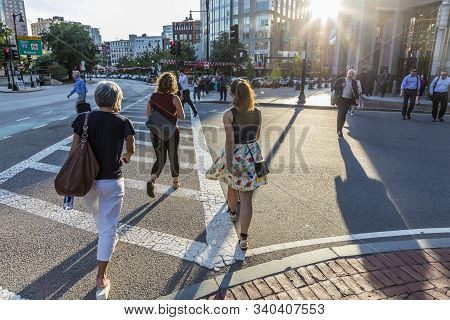 Boston, Usa - Sep 12, 2017: People Crossing The Street At A Pedestrian Crossing Stripe Downtown Bost