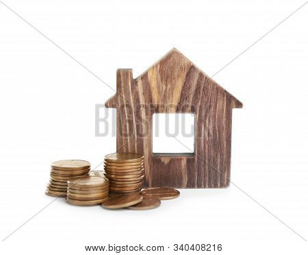House Model And Coins Isolated On White