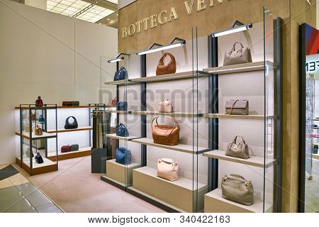 BERLIN, GERMANY - CIRCA SEPTEMBER, 2019: Bottega Veneta bags on display at the Kaufhaus des Westens (KaDeWe) department store in Berlin.