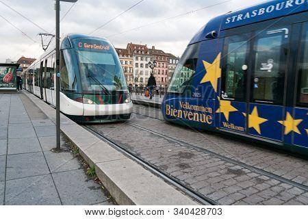 Strasbourg, Bas-rhin / France - 14. December, 2019: City Trams On The Pont Royal Bridge In The Histo