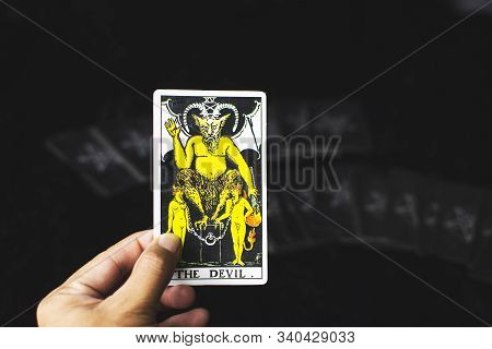 Rayong Province,thailand - December 16 2019, The Devil Card Tarot In A Left Hand Of Fotune Teller Fo