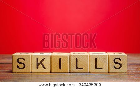 Wooden Blocks With The Word Skills. Knowledge And Skill. Self Improvement. Education Concept. Traini