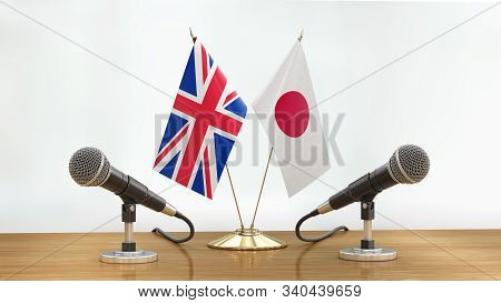 3d Illustration. Microphones And Flags Pair On A Desk Over Defocused Background