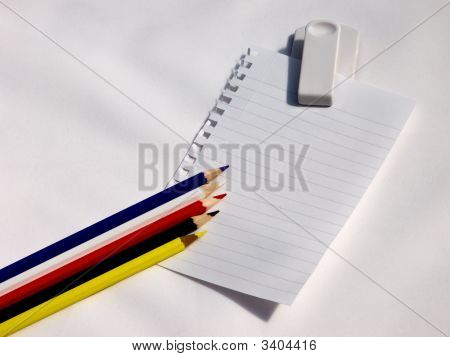 Blank Note On White Clip With Colored Pencils.