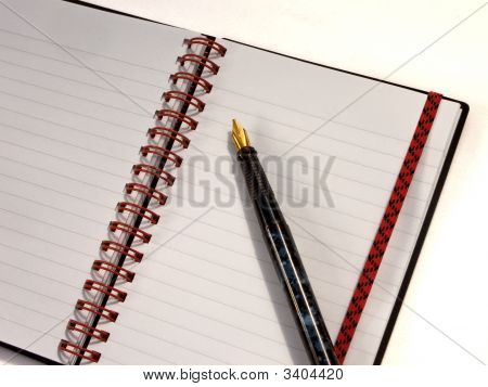 Spiral Notebook Open With Pen