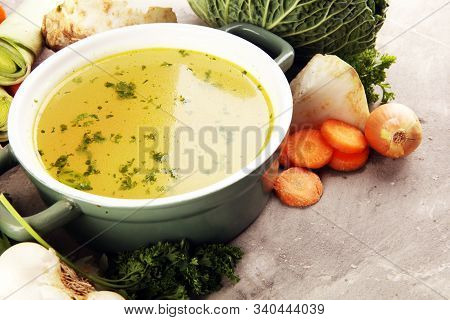Broth With Carrots, Onions Various Fresh Vegetables In A Pot - Colorful Fresh Clear Spring Soup. Rur
