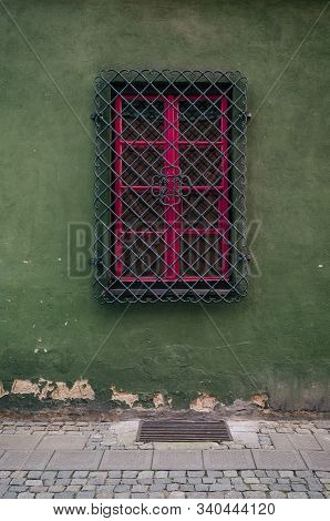 WINDOW BEHIND BARS - A historic tenement house in a side street of old Poznan poster