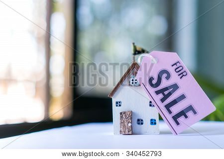 Home For Sale And Real Estate Mortgage Concept: Diy Little House Model With Tag Paper