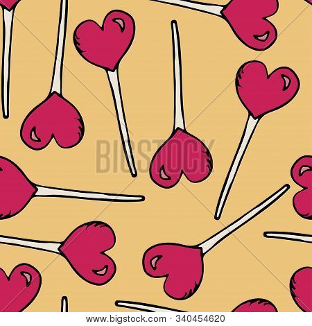 Texture Of Lollipops On A Stick In The Form Of Hearts On A Yellow Background. Hand Drawn Caramel In