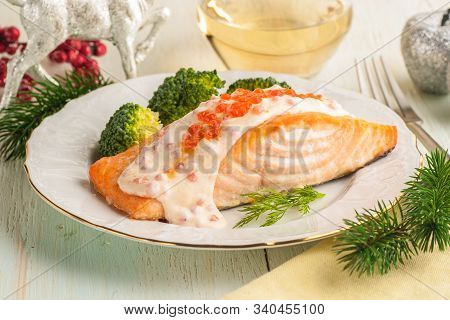 Baked Salmon Fillet With Broccoli And Creamy Sauce. Main Course For Lunch Or Dinner With Christmas D