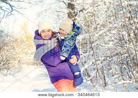 A Mother And Baby In Winter Park
