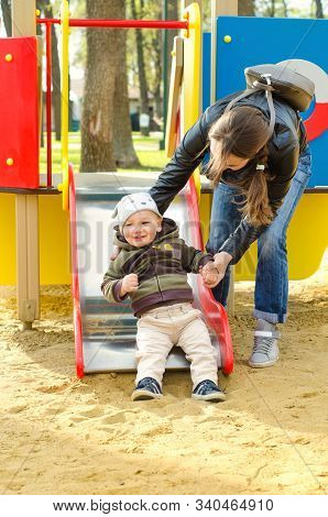 A Mother And Baby At The Playground