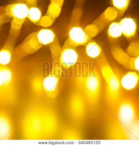 A Christmas Background Of Defocused Garland Lights