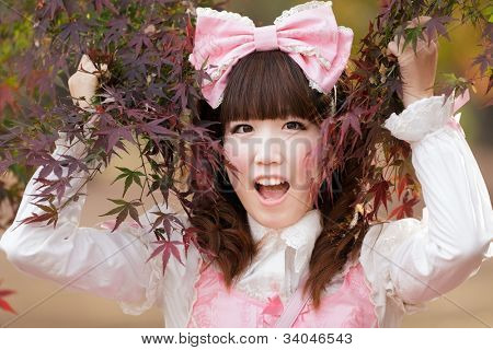 japanese girl in lolita cosplay fashion in park
