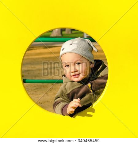 Little Boy Playing At The Playground Outdoors