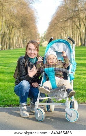 A Mother And Baby In The Park