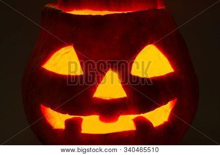 Halloween Pumpkin Face On A Black Background