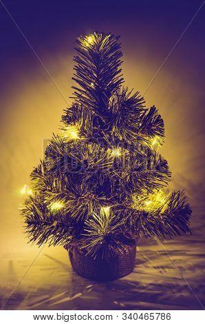 A Christmas Tree On A Dark Background