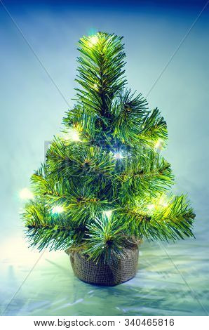 A Christmas Tree On A Blue Background