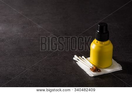 Medical Iodine In A Bottle And Gauzes On Black Background.copy Space