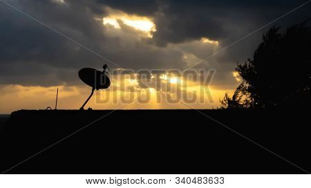 The Silhouette View Of The Astro Plate On The Roof Of Building With Sunrise Light As Background In T