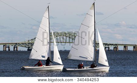 Close Up Of Two Two Person Saiboats Sailing On A Cold December 2019 Day In The Great South Bay With