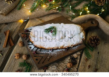 Homemade Traditional German Bread Dessert Stollen With Powdered Sugar And Spruce Branch, Cranberry O