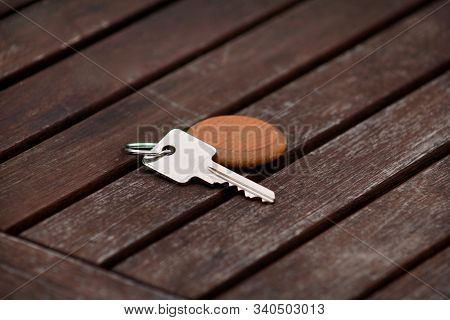 Hotel Suite Key With Wooden Fob For Room On Wood Table. Room Key On Wood Texture And Background. Sil