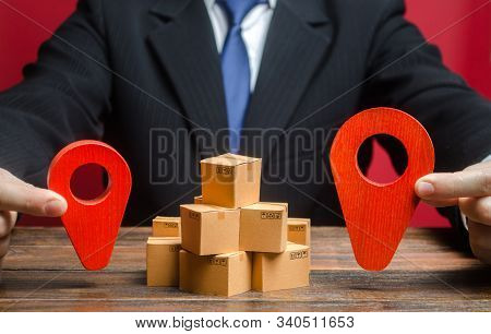 A Businessman Sets A Destination For Goods Delivery. Global Market And Business, Import And Export.