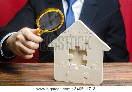 Man Studies The Missing Piece In Puzzles House. Purchase Or Construction Comfortable Dream Home. Mor