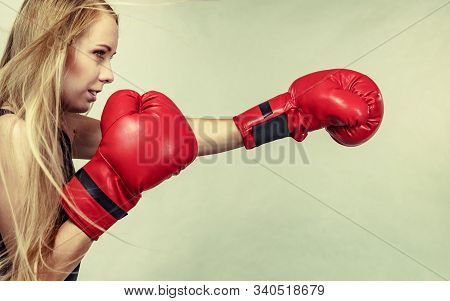 Bloned Long Hair Girl Boxer In Big Fun Red Gloves Playing Sports Boxing. Female Fight For Equal Righ